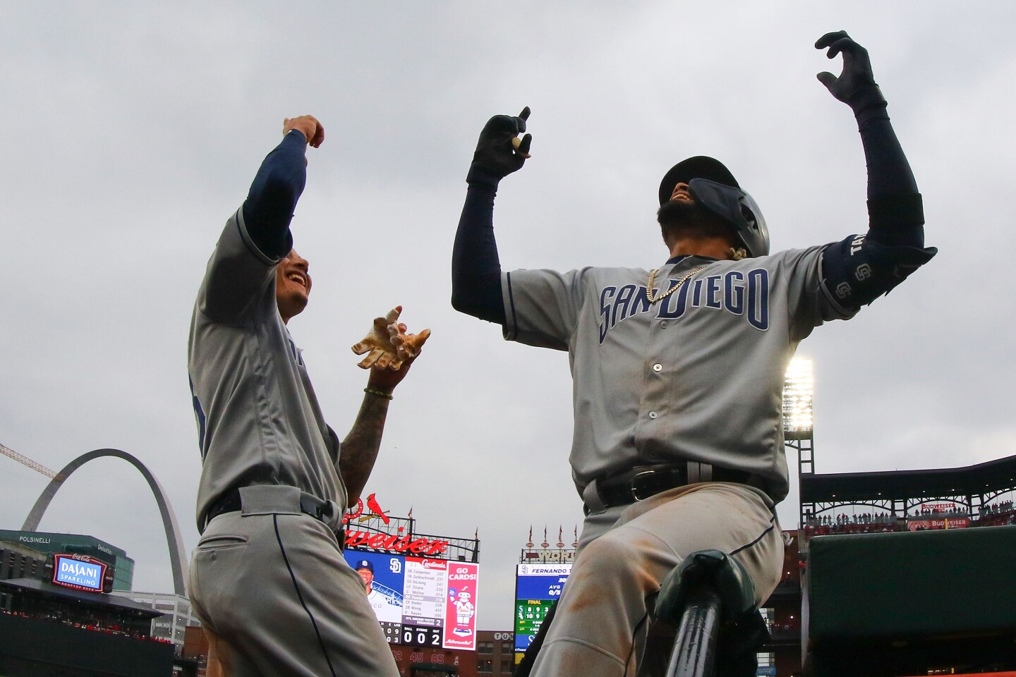 ST. LOUIS, MO - APRIL 5: Manny Machado #13 of the San Diego Padres congratulates Fernando Tatis Jr. #23 of the San Diego Padres after Tatis Jr. hits two-run home run against the St. Louis Cardinals in the seventh inning at Busch Stadium on April 5, 2019 in St. Louis, Missouri. (Photo by Dilip Vishwanat/Getty Images) ** OUTS - ELSENT, FPG, CM - OUTS * NM, PH, VA if sourced by CT, LA or MoD **