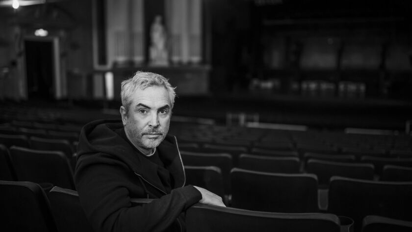"""Alfonso Cuaron sits inside the Teatro Metropolitan in Mexico City, where he shot keys scenes from """"Roma."""""""