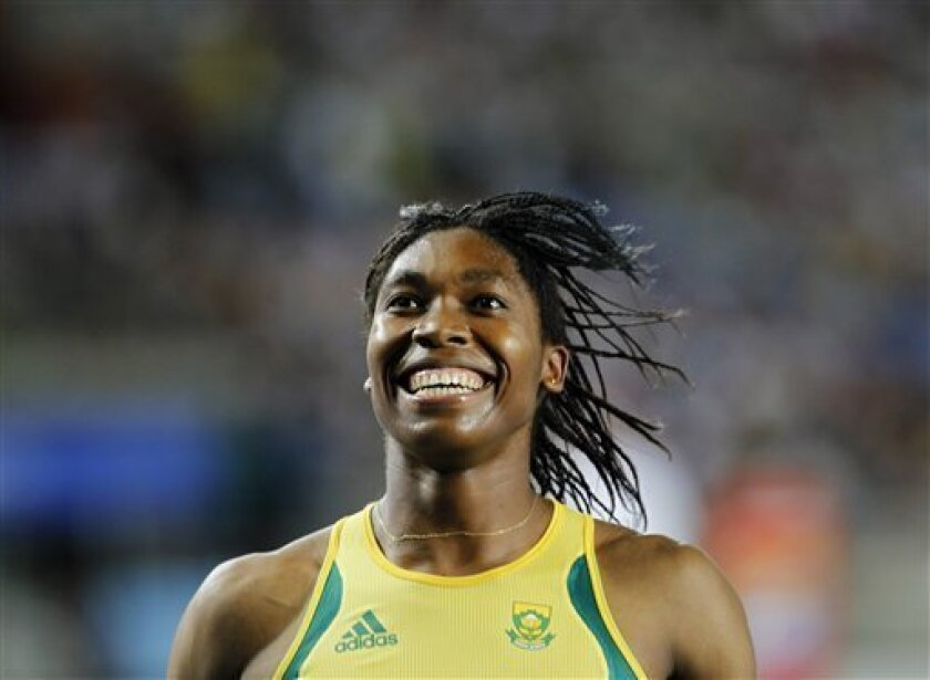 South Africa's Caster Semenya celebrates winning silver in the Women's 800m final at the World Athletics Championships in Daegu, South Korea, Sunday, Sept. 4, 2011. (AP Photo/Lee Jin-man)