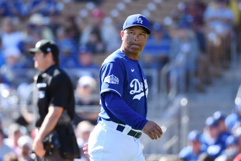 Dodgers manager Dave Roberts looks on during a spring training game at Camelback Ranch on Feb. 26.