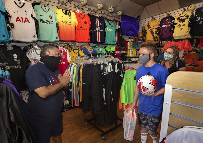 Carlos Marroquin, owner of Planet Soccer in Newhall, thanks customers.