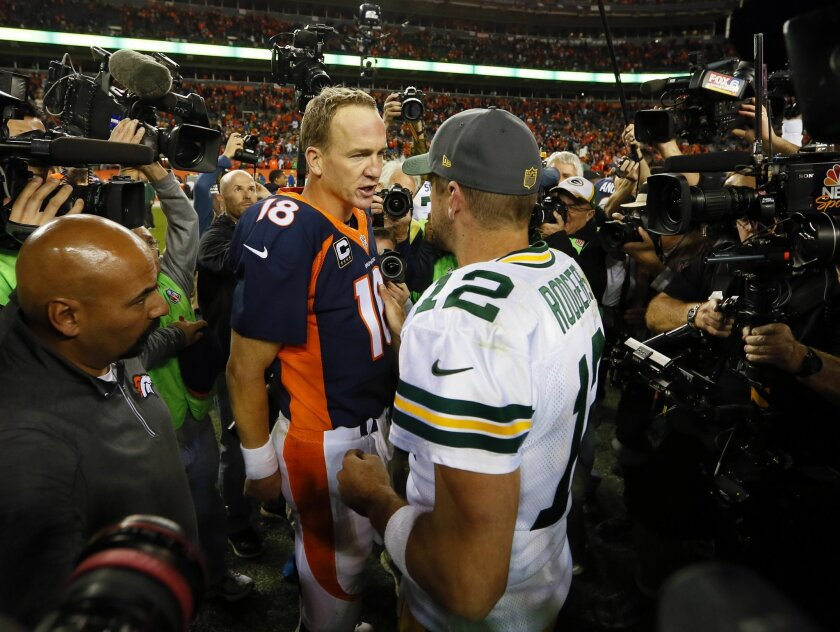 Denver Broncos quarterback Peyton Manning (18) greets Green Bay Packers quarterback Aaron Rodgers (12) after an NFL football game, Sunday, Nov. 1, 2015, in Denver. The Broncos won 29-10 to improve to 7-0. (AP Photo/Joe Mahoney)