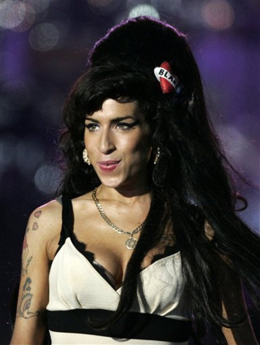 In this June 27, 2008 file photo, British singer-songwriter Amy Winehouse performs at the 46664 charity concert in honor of Nelson Mandela's 90th birthday in London. Winehouse has dropped her appeal in a Norwegian drugs case and will accept her fine for illegal possession of marijuana in 2007, he