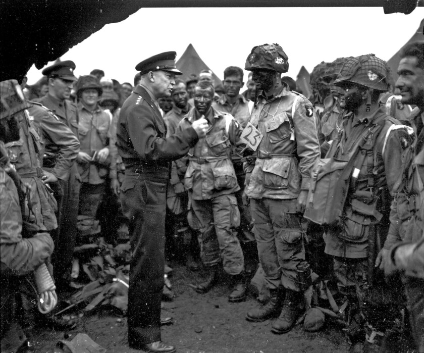 """Supreme Allied Commander Gen. Dwight Eisenhower gives the order of the day, """"Full victory -- nothing else,"""" to paratroopers of the 101st Airborne Division in England before the D-day invasion of Nazi-occupied France in June 1944."""