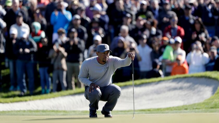 Tiger Woods looks over his ball on the 18th hole of the North Course during the second round of the Farmers Insurance Open golf tournament on Jan. 27.