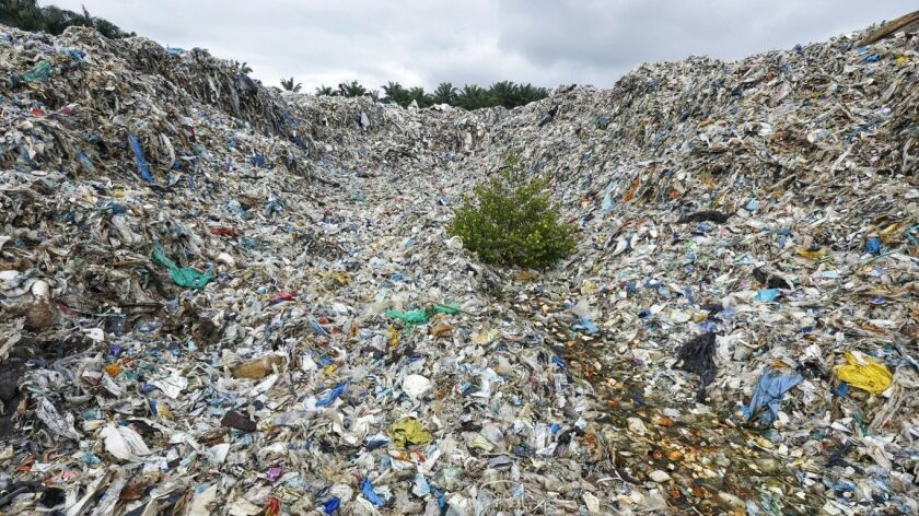 A Greenpeace photographer captured this image of a dump site for imported plastic waste in Jenjarom, Malaysia.