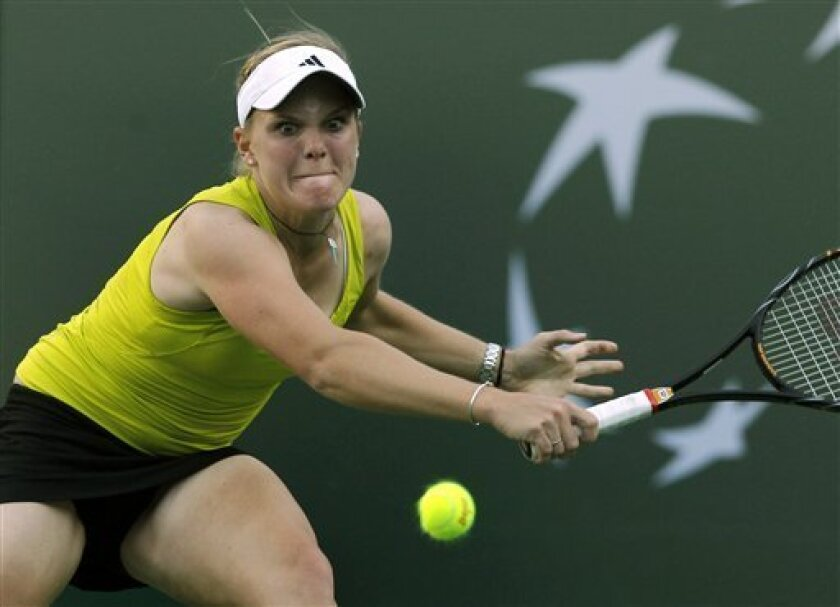 Melanie Oudin hits to Roberta Vinci, of Italy, in their match during the BNP Paribas Open tennis tournament in Indian Wells, Calif., Thursday, March 11, 2010.  (AP Photo/Chris Carlson)