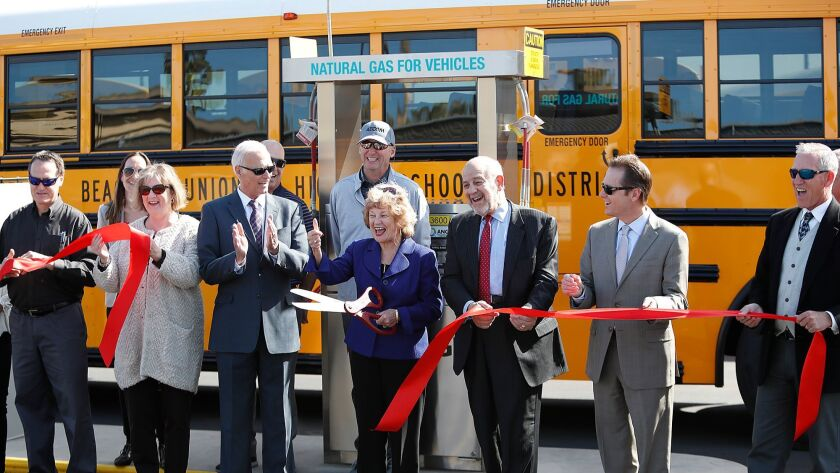 Dr. Bonnie Castry cuts a ribbon during a ceremony for the Huntington Beach Union High School Distric