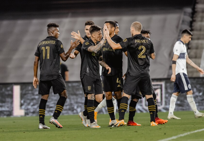 LAFC players celebrate during a game against the Vancouver Whitecaps.