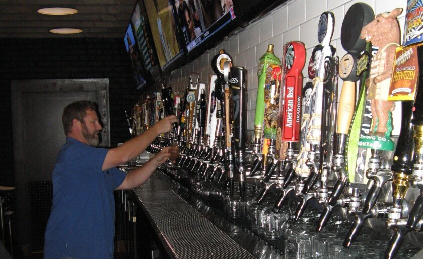 Slater's 50/50 Beermonger Mark Schultz pulls a draft at the 101-tap bar in the new San Marcos location.
