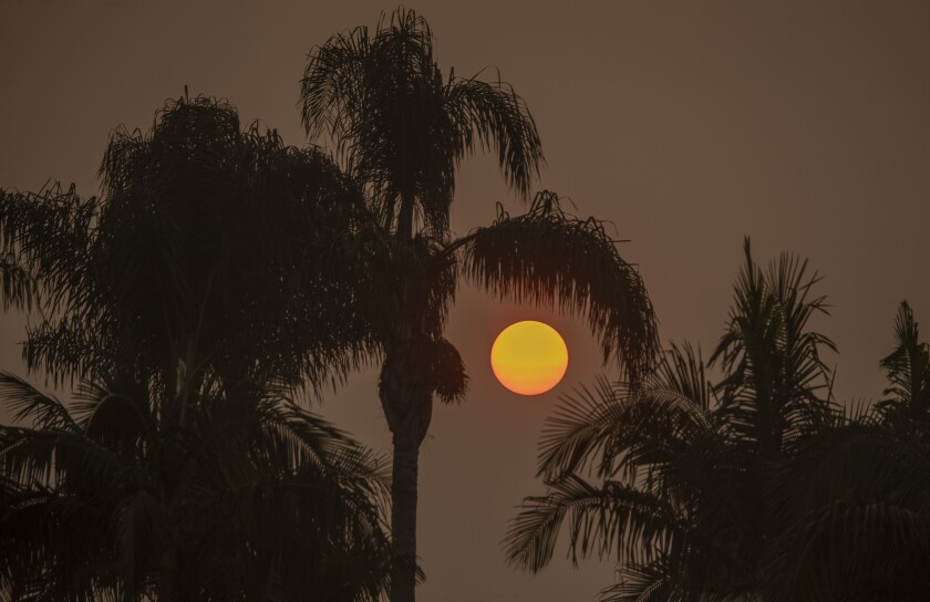 The sun is filtered through smoky air from California's record wildfires.