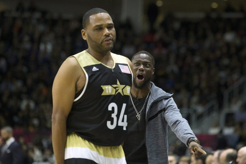 United States' coach Kevin Hart, right, offers advice to O'Shea Jackson Jr. during the Celebrity Game, part of NBA basketball's All-Star weekend, in Toronto, Friday, Feb. 12, 2016. (Chris Young/The Canadian Press via AP) MANDATORY CREDIT