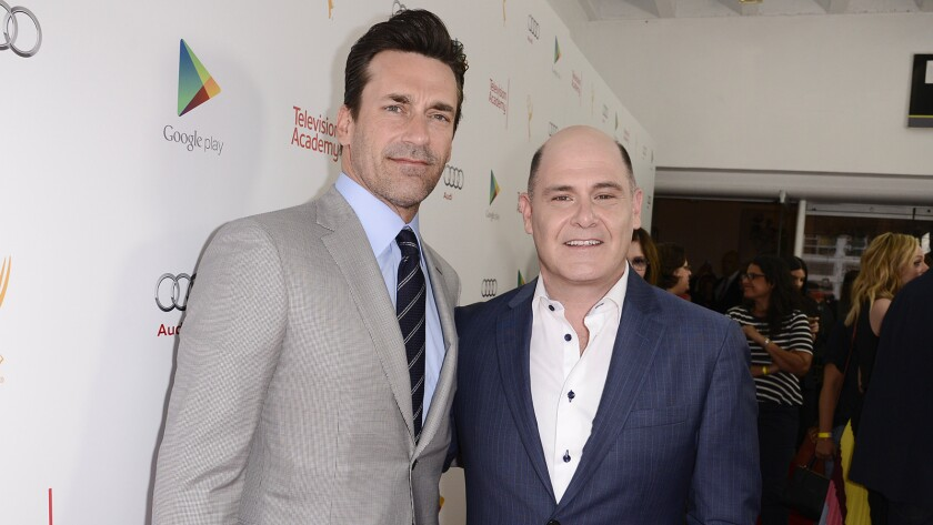 """Actor Jon Hamm, left, and """"Mad Men"""" creator, director, executive producer and writer Matthew Weiner explore """"The Mad Men Experience"""" from Google Play at the TV Academy's """"Farewell to Mad Men"""" event at the Montalban Theater in Hollywood."""