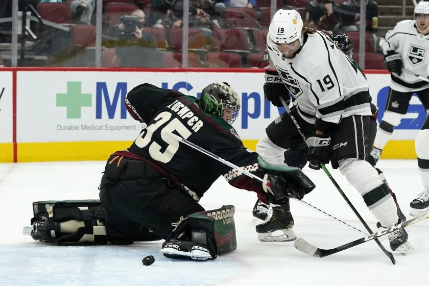 Los Angeles Kings right wing Alex Iafallo (19) beats Arizona Coyotes goaltender Darcy Kuemper (35) for a goal during the second period of an NHL hockey game Monday, May 3, 2021, in Glendale, Ariz. (AP Photo/Ross D. Franklin)