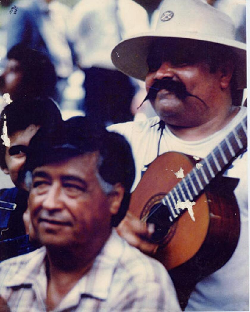"""Cesar Chavez and Ramon """"Chunky"""" Sanchez at a United Farm Workers rally in the 1980s."""