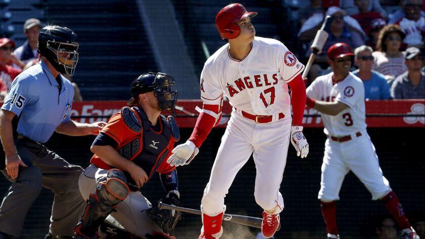 ANAHEIM, CALIF. - JULY 22, 2018. Angels designated hitter Shohei Ohtani storkes a single against th