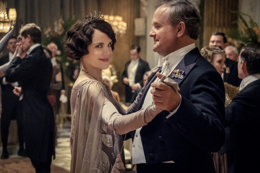 """Elizabeth McGovern as Lady Grantham dances with Hugh Bonneville, as Lord Grantham, in """"Downton Abbey""""."""