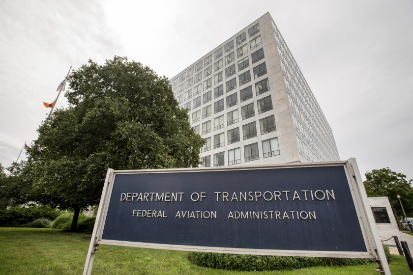 FILE - In this June 19, 2015 file photo, Department of Transportation Federal Aviation Administration building is seen in Washington. The Federal Aviation Administration said Wednesday, June 2, 2021 that Ali Bahrami, the head of FAA's aviation safety office, will step down at the end of June. Bahrami was among FAA officials who were criticized by lawmakers and relatives of passengers on Boeing Max jets that crashed. (AP Photo/Andrew Harnik, File)