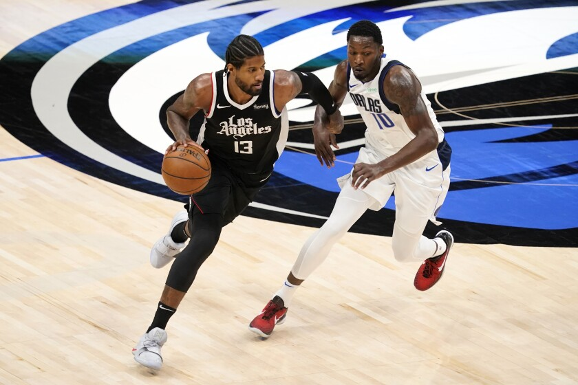 The Clippers' Paul George works against the Dallas Mavericks' Dorian Finney-Smith on May 30, 2021.