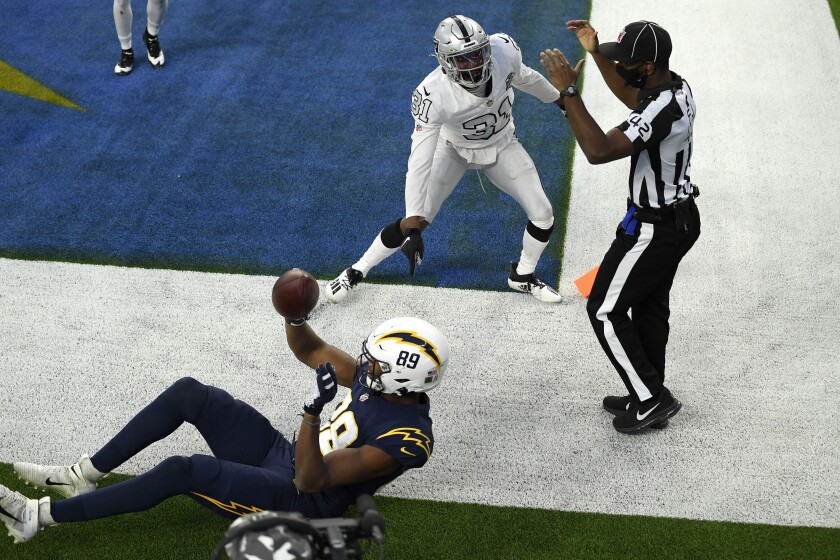 Donald Parham Jr. of the Los Angeles Chargers celebrates what he thought was winning TD but was overturned on replay.