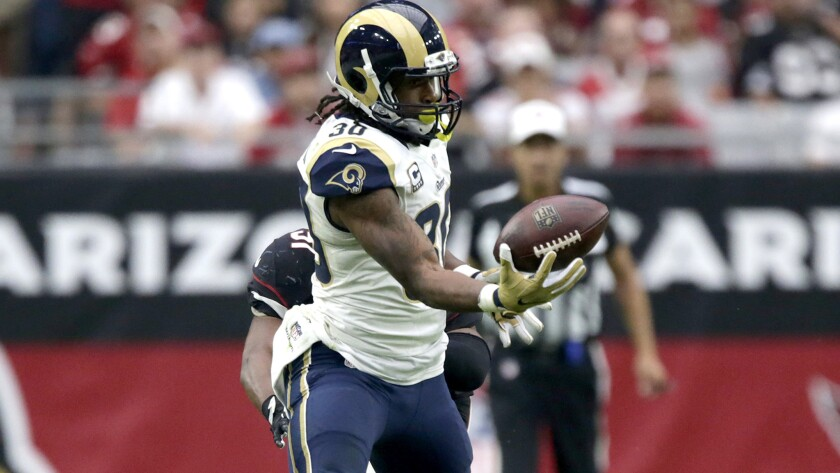 Rams running back Todd Gurley, making a one-handed catch against the Cardinals last weekend, has rushed for only 216 yards this season.