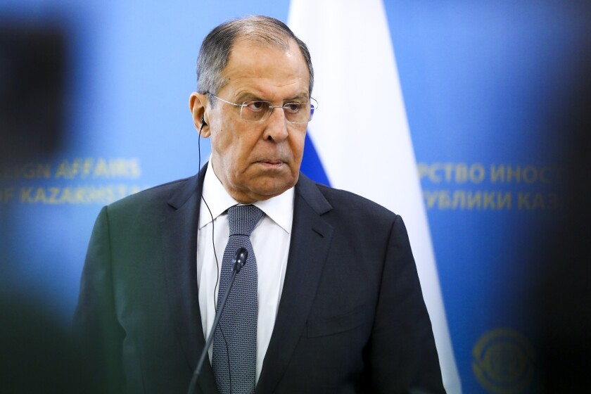 In this handout photo released by Russian Foreign Ministry Press Service, Russian Foreign Minister Sergey Lavrov listens to a journalist's question during his and Kazakh Foreign Minister Mukhtar Tleuberdi joint news conference following their talks at the Ministry of Foreign Affairs in Nur-Sultan, Kazakhstan, Thursday, April 8, 2021. (Russian Foreign Ministry Press Service via AP)