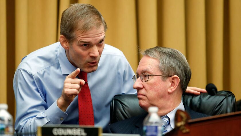 Rep. Jim Jordan (R-Ohio), left, talks with House Judiciary Committee Chairman Robert W. Goodlatte (R-Va.) during a recent hearing on Capitol Hill.
