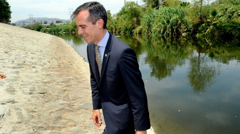 Los Angeles Mayor Eric Garcetti walks along the L.A. River in 2014.