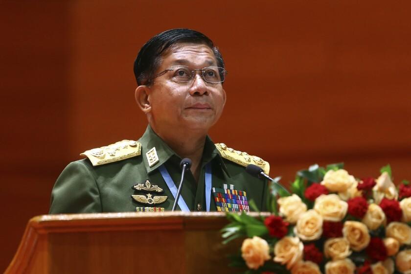 Senior Gen. Min Aung Hlaing speaks at a podium.