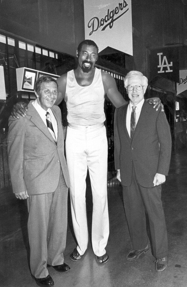 Dr. Frank Jobe, right, and Dr. Robert Kerlan flank Lakers star Wilt Chamberlain at a 1982 Dodger Stadium party honoring the work of orthopedic surgeons who helped prolong athletes' careers.