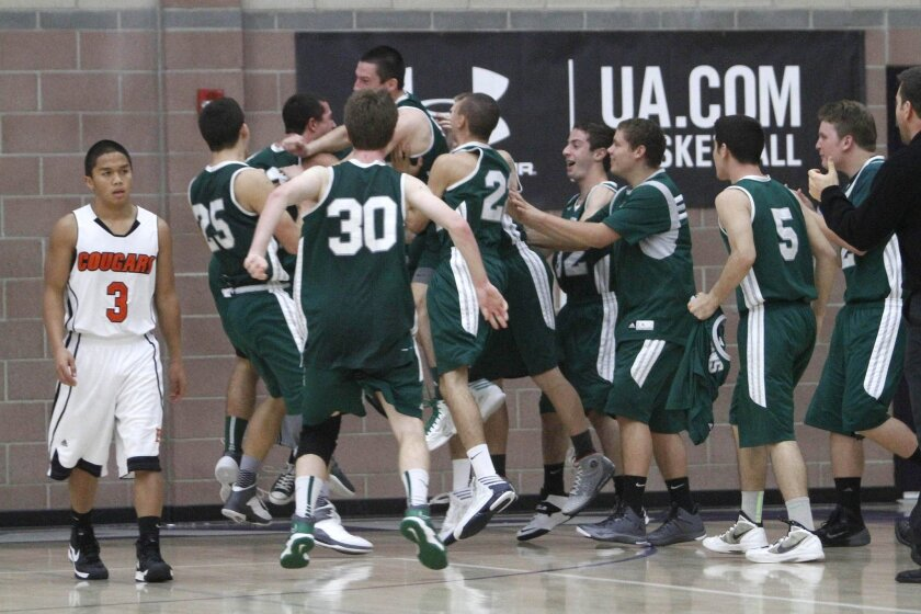 Poway players celebrate the Titans' buzzer-beater shot against Escondido in the Under Armour Holiday Classic.