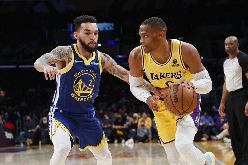 Lakers guard Russell Westbrook drives against Warriors forward Chris Chiozza.