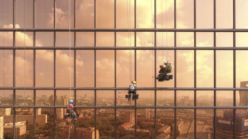 Alexey Goncharov's high-flying photograph of window washers earned him second prize in the urban category of the 2017 Dronestagram contest.