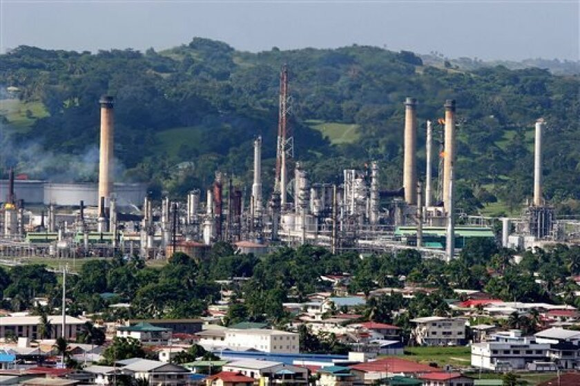 FILE - In this Sept. 5, 2005 file photo, the refinery of the state-owned Petroleum Company of Trinidad and Tobago Ltd., PETROTRIN, is shown in Pointe-a-Pierre, on the Gulf of Paria, Trinidad & Tobago. From the Bahamas and Cuba down to Aruba and Suriname, international oil companies are lining up to