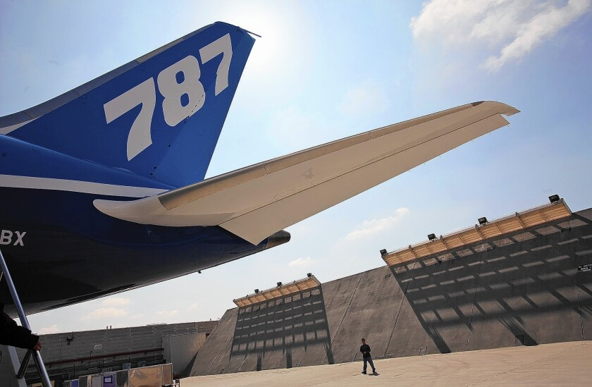 The addition of highly skilled engineering jobs is expected to provide an economic boost to the Southland and Long Beach. Above, a 787 Dreamliner sits on the tarmac at the Boeing plant in Long Beach.
