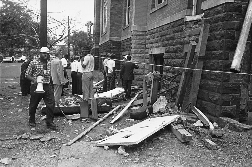 Investigators and others gather at the scene outside the 16th Street Baptist Church in Birmingham, Ala., following the 1963 bombing that killed four African American girls.
