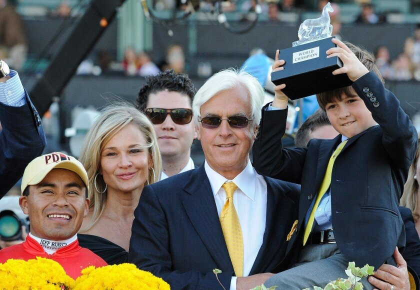 Trainer Bob Baffert savors every moment in racing and with family now after surviving a near fatal heart attack three years ago in Dubai. He's shown here after Bayern won the BC Classic.
