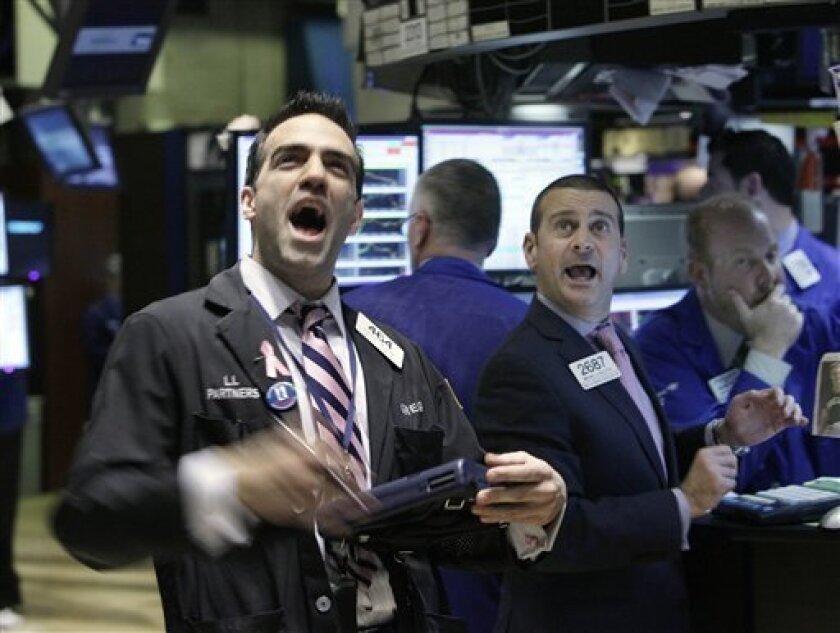 Trader Gregory Rowe, left, and specialist Michael Sollitto, center, react on the floor of the New York Stock Exchange as the Dow Jones Industrial Average briefly dips below 10,000, Thursday, Feb. 4, 2010. Stocks buckled Thursday under the growing belief that the global economy is weaker than many investors expected and likely to stop companies from hiring. The Dow Jones industrials briefly traded below 10,000 for the first time in three months. (AP Photo/Richard Drew)