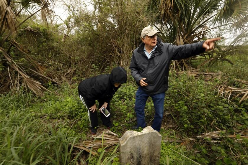 PHARR, TEXAS--FEB. 9, 2019--Juan Granado, age 73, and his wife Esmeralda Granado look at the grave s