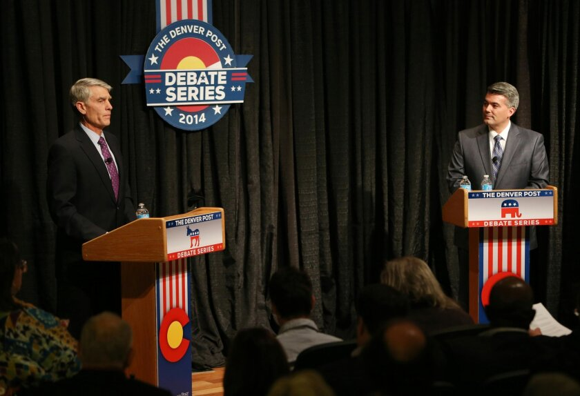 FILE - In this Oct. 7, 2014 file photo, Sen. Mark Udall, D-Colo., left, takes part in a debate with his Republican challenger, Rep. Cory Gardner, R-Colo., at The Denver Post in Denver. Gardner has more campaign cash on-hand than Udall as their tight contest heads into its final weeks, the campaigns said Thursday.Gardner has $3.3 million available as of Sept. 30, while Udall's campaign Thursday said it had $1.9 million cash on hand as of that date. Gardner outraised Udall, $4.3 million to $4 million during the third quarter of the year. (AP Photo/David Zalubowski, File)