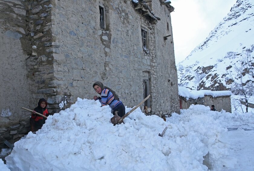 Afghan children looks on in a village close to an avalanche site in Panjshir province north of Kabul, Afghanistan, Wednesday, Feb. 25, 2015. Avalanches caused by a heavy winter snow killed at least 124 people in northeastern Afghanistan, an emergency official said Wednesday, as rescuers clawed through debris with their hands to save those buried beneath. (AP Photo/Massoud Hossaini)