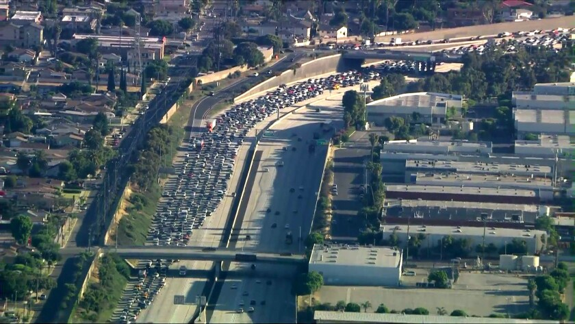 The 110 in Gardena is jammed with traffic after being shut down following reports of a shooting.