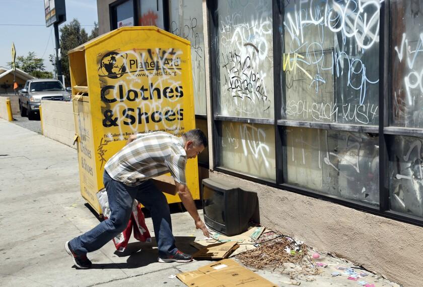 Garbage near a donation box