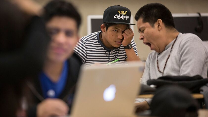LOS ANGELES, CALIF. -- THURSDAY, MAY 12, 2016: Belmont High student Marcos Gaspar, center, tired fro
