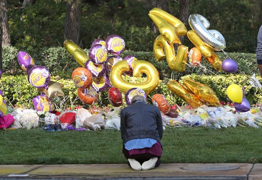 A woman prays at the memorial shrine.