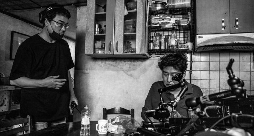 """Bong Joon Ho and Song Kang Ho on the set of """"Parasite"""""""