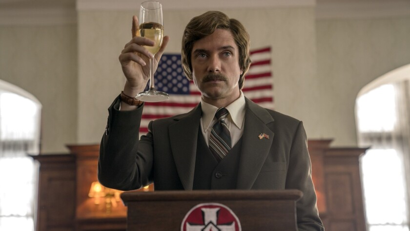 "This image released by Focus Features shows Topher Grace in a scene from ""BlacKkKlansman."" (David Le"