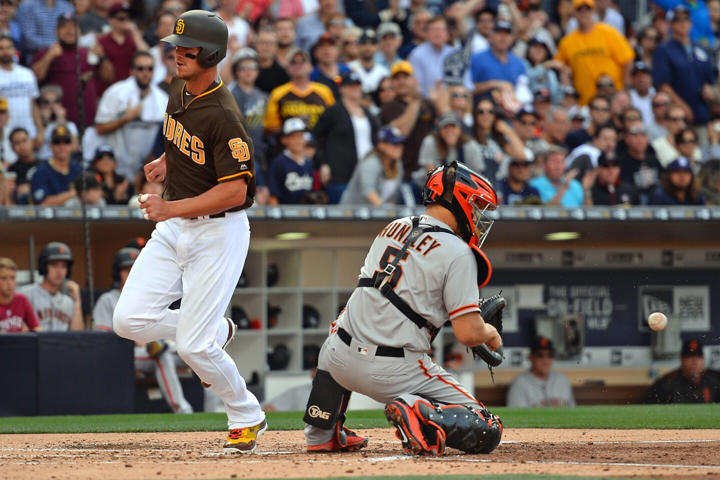 Apr 7, 2017; San Diego, CA, USA; San Diego Padres first baseman Wil Myers (L) scores ahead of the throw to San Francisco Giants catcher Nick Hundley (5) during the third inning on a single by third baseman Yangervis Solarte (26) at Petco Park. Mandatory Credit: Jake Roth-USA TODAY Sports ** Usable by SD ONLY **