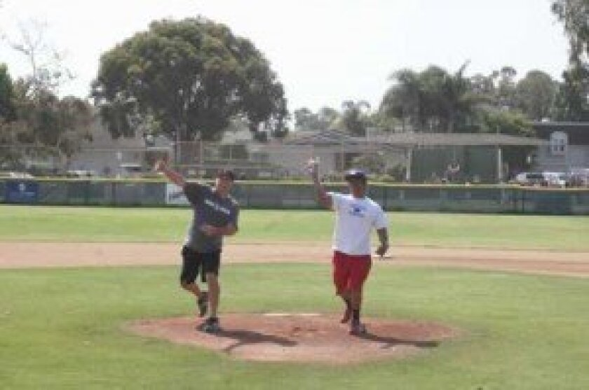 """La Jolla Youth Baseball """"legends"""" Paul Delmore (L) and Roy Agbulos (R) throw out the first pitch on Bronco Field."""