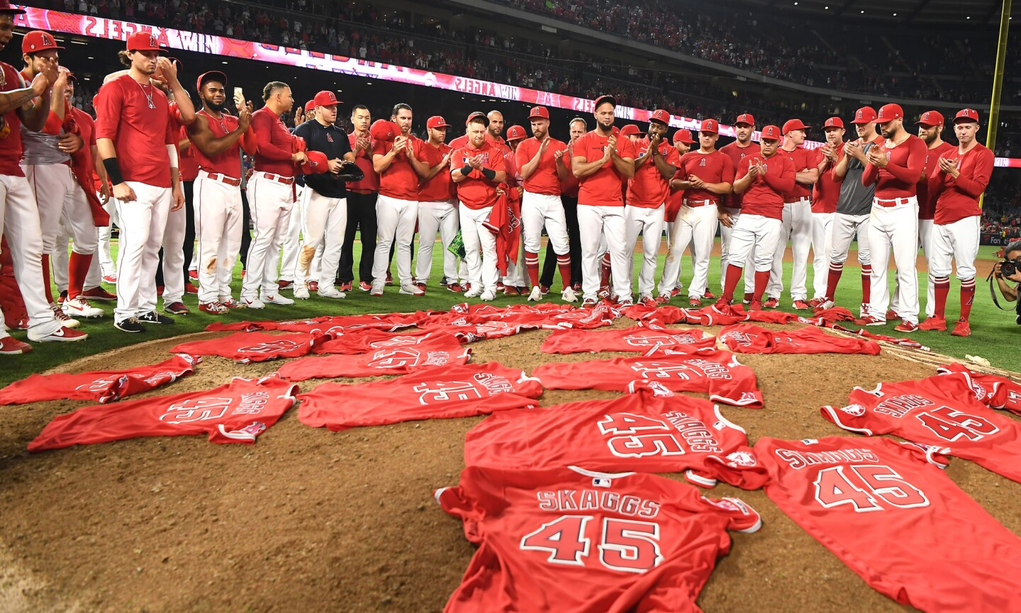 Angel players place their Tyler Skaggs jerseys at the pitchers mound after no-hitting the Mariners.